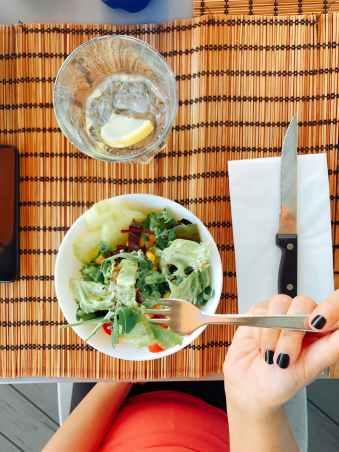 vegetable salad on white bowl served on table